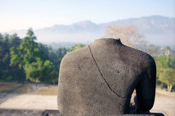 A headless sculpture at the Borobudur temple, outside of Yogyakarta, Indonesia.